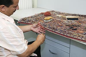 Repair of an oriental carpet.